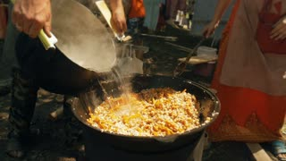 Cooking Pilaf In Cauldron Outdoors. Slow-mo