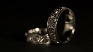 Jewel. White Gold Rings Rotates On A Black Background