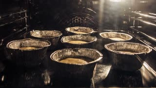 Muffins. Baking in oven. Time lapse