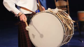 Musical performance. Men play the drum