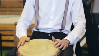 Musical performance. Musician play the hand drum