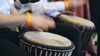 Musical performance. Musicians play the hand drum