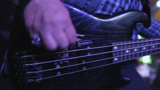 Rock Concert. Rock Musician Playing Bass Guitar