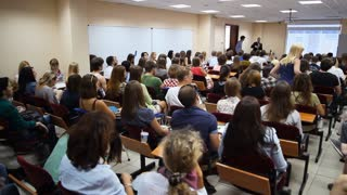 Russia, Tolyatti, August 2, 2015: Audience listened to speakers at a business seminar in a small room