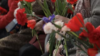 Russia, TolyattI, May 9, 2015: Older women with flowers at the Military Parade. Victory Day