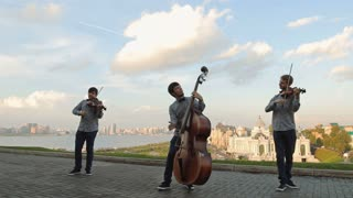 Street musicians. Guys playing musical stringed instruments on the street