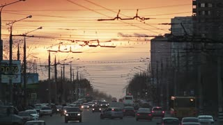 Traffic on Russian highway at sunset background