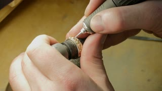 Jewelry Work. Processing of Gold Ring. Close-Up