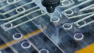 Laser Cutting Machine At Work. Acrylic Plastic Cutting. Close-up