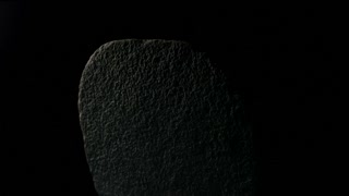 Stone Rotates On Black Background Close-up
