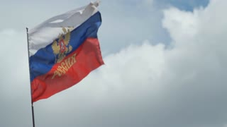 Waving in the wind Russian flag on a background sky