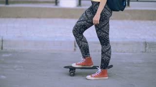 Woman With Longboard. Female Legs, Leggings, Red Sneakers