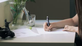 Young Beautiful Woman Draws A Sketch In Office
