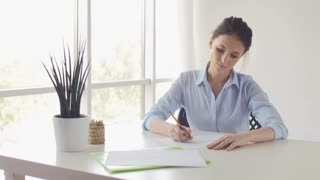 Young Beautiful Woman Draws A Sketch Of The Window In Office