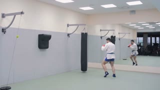 Young Fighter Trains With Punching Bag In The Gym