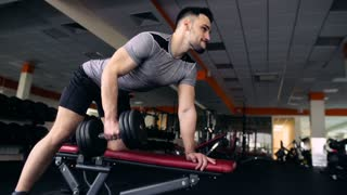 Young Male Athlete Exercising With Dumbbells