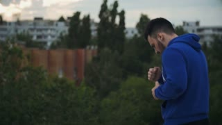 Young Man Shadow Boxing On The Roof. Cinematic. Slow-Mo