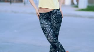 Young Sexy Beautiful Woman In Leggings Posing On The Street. Slow-Mo