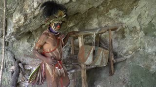 Aboriginal man at cave entrance in Papua New Guinea