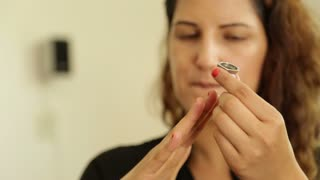 Beuatiful woman tries on a ring