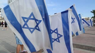 Bnei Akiva youth with flags of Israel