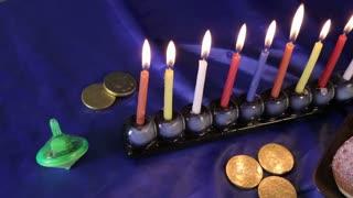 Dolly over Hanukkah table
