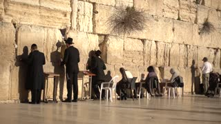 Jewish People Pray in front of The Western Wall