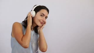 long clip of woman having fun listening to music