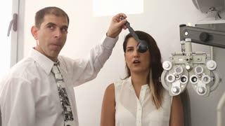 Optometrist with patient during cover test
