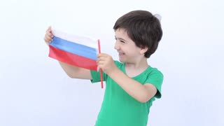 Russian kid holding a flag of Russia