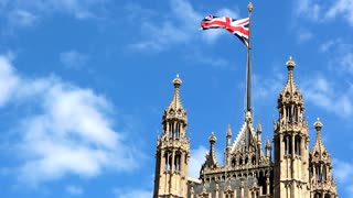 Shot of British flag over the Parliament house, Westminster