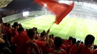 Shot of football crowd clap hands