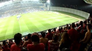 Shot of Soccer game spectators cheer