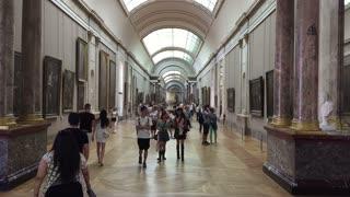 Shot of Visitors Walking in the Louvre museum of Paris