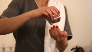 Therapist Using Hot Oils For Treatment