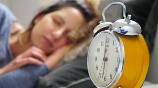 Woman Wakes From Alarm Clock In The Morning