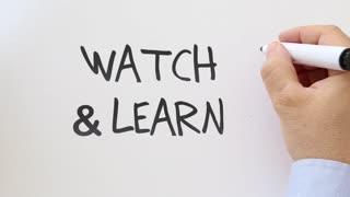 Watch and learn written on whiteboard