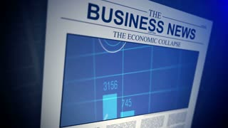 4K. Newspaper with business news. Shallow Depth of field.