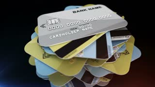 A pile of credit cards rotates with depth of field and reflections. Shopping concept. Seamless loop.