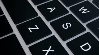 Closeup of laptop's keyboard pan.