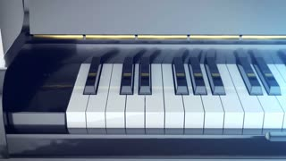 Keys of a piano are pressed and then the piano is closed. Classic music concept.