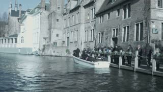 People sit in a boat on the river. Bruges, Belgium.