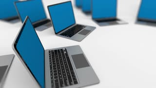 Some laptops departing into distance. Loopable. Depth of field.