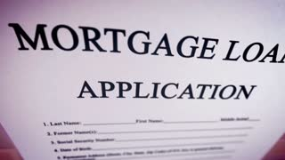 Animation video with Blank Mortgage loan application on a paper sheet.
