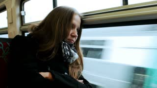 Young woman traveling by train.