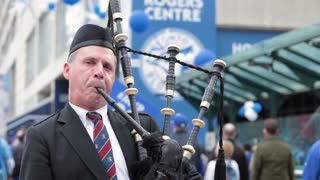 Bagpipes player outside rogers centre close up face