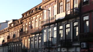 Beautiful light from sun reflecting on windows early morning Porto, Portugal