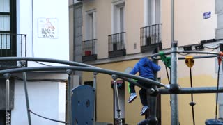 boy climbing down from playground