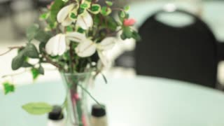 Flowers on empty table soup kitchen