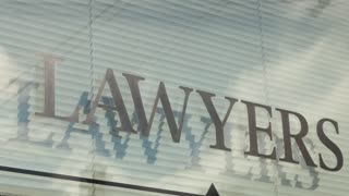 Lawyers sign with shadows